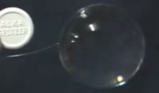 Alka-Seltzer added to spherical water drop in microgravity